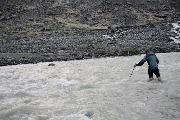 Mike attempts to cross the glacial stream