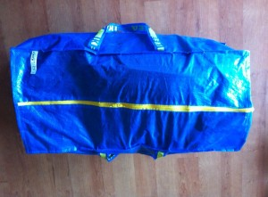 The Ikea bag closes with the bike bags