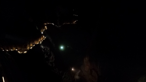 The lit up path in the massive cavern