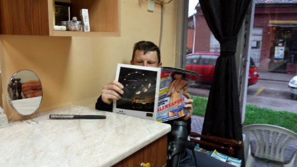 Browsing the reading material at the barber