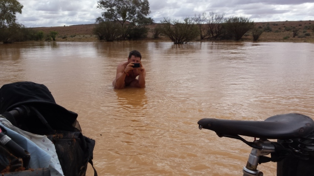 Taking a photo of Clement crossing the river